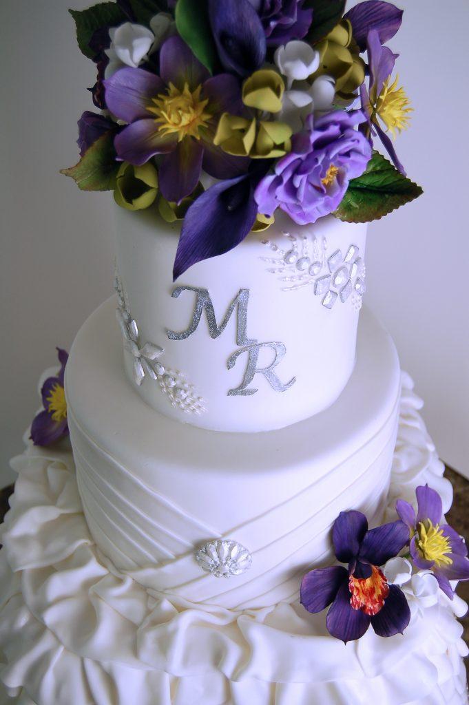 Huascar & Company Bakeshop White Wedding Cake with Sugar Flowers